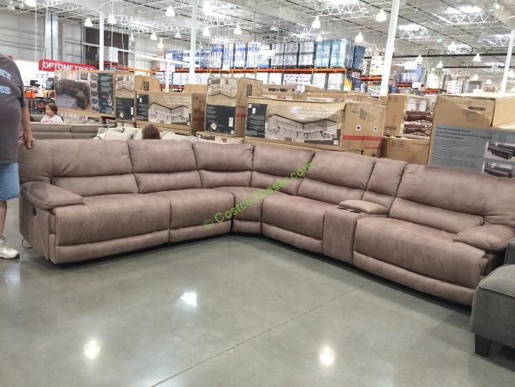 This roomy Fabric Power Reclining Sectional has oversized seat width