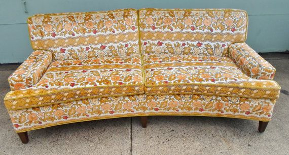 Really cute vintage yellow flower print sofa loveseat. Love this