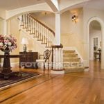 Foyer with maple hardwood floors and carpeted staircase Picture | u22861004